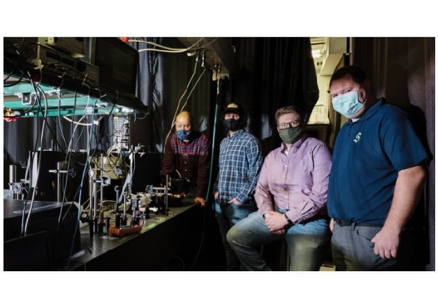 Researcher Rob Walker (far left) with students in his lab. Image used courtesy of MSU