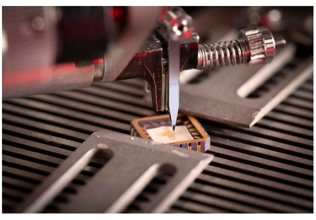 Wire bonding of a Hall-Effect sensor to a chip carrier using a wedge bonder. Image courtesy of Paragraf.