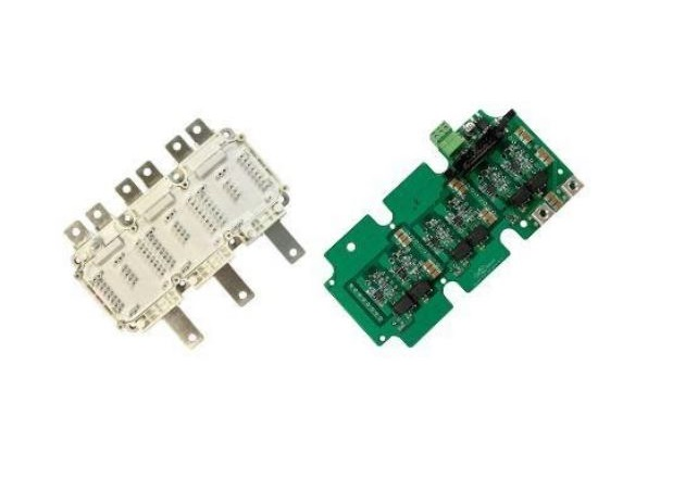 Power module (left) and driver board (right). Image courtesy of GaN Systems GS-EVx-3PH-650V300A-SM1x Technical Manual