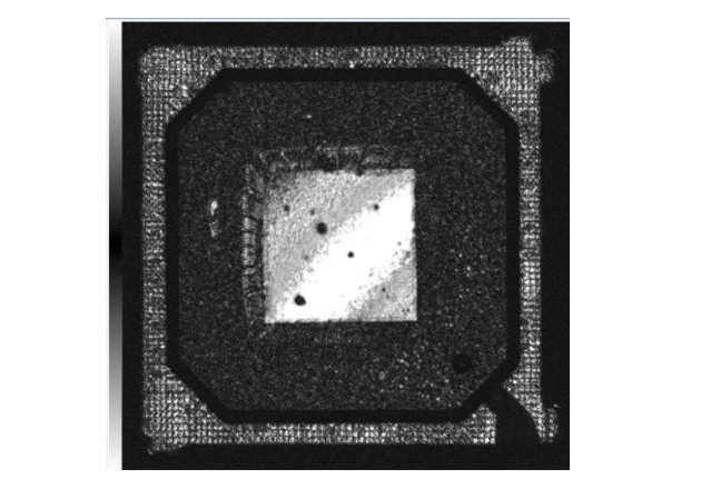 Figure 2: A very narrow (vertically) gate was used to reveal die tilting inside this plastic BGA package.