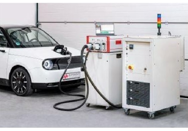 The SL1200A (right) pictured with the SL1040A Charging Discovery System (middle) testing an EV's onboard charger. Image courtesy of Keysight