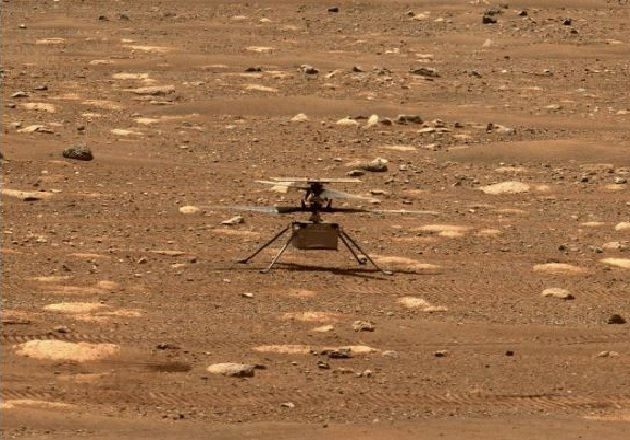 Ingenuity after releasing its blades on Mars' surface. Imaged used courtesy of NASA.