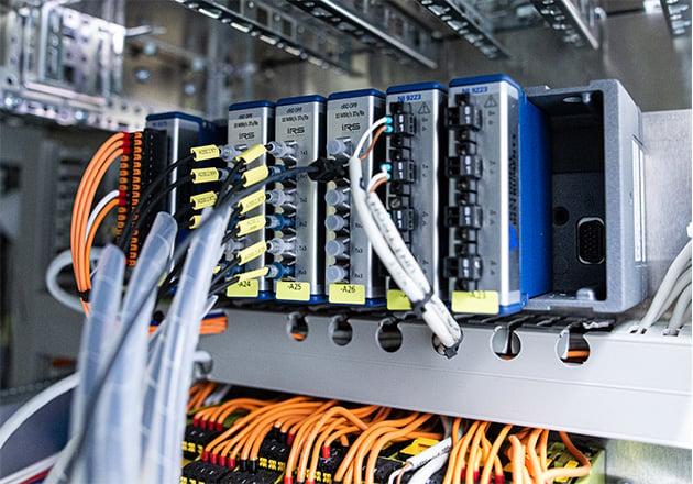 Time-precise control via fiber optic cables and analog measurement