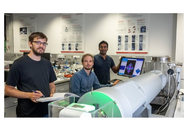 Researchers from Graz University, Harald Fitzek, Christian Prehal, and Qamar Abbas (from left) at the SAXS facility SAXSpoint 2.0 (Anton Paar GmbH). Image used courtesy of Graz University