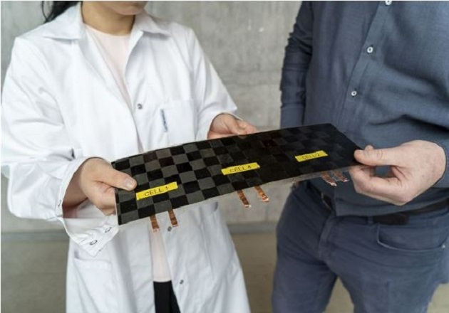 Dr. JohannXu wi and Professor Leif Asp with a newly manufactured structural battery cell in Chalmers' composite lab. Image used courtesy of Chalmers University of Technology