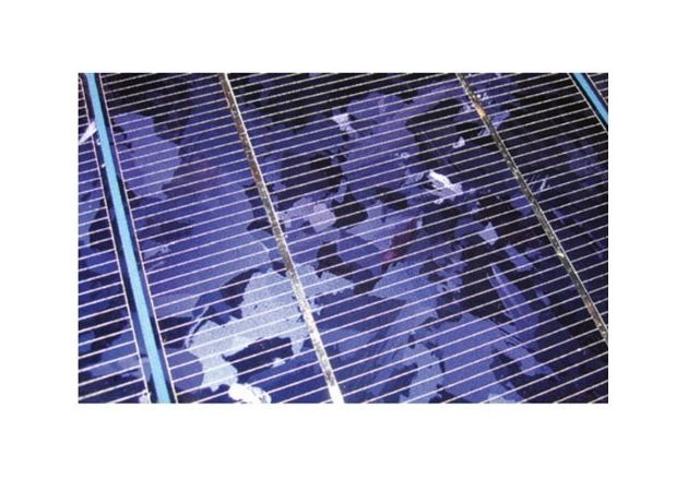 Figure 4. PV cells are wafers made of crystalline semiconductors covered with a grid of electrically conductive metal traces.