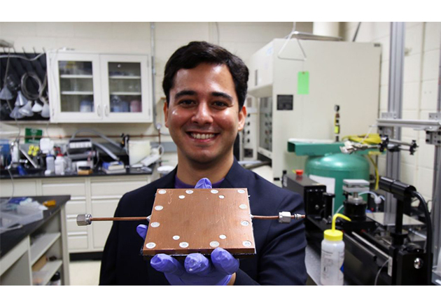 Mojtaba Edalatpour, a research team member of Boreyko's lab holds up the newly-devised thermal diode.