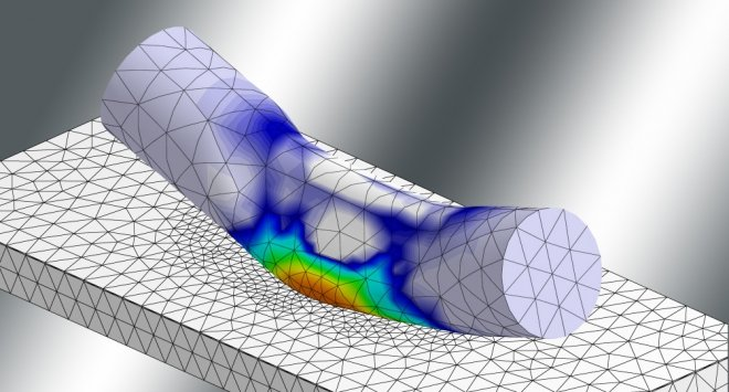 Finite element simulation submodel of wire bond wedge on semiconductor. The colors depict the strain distribution due to active power cycling.